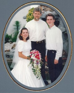 Our wedding day, with our pastor, Ernie.